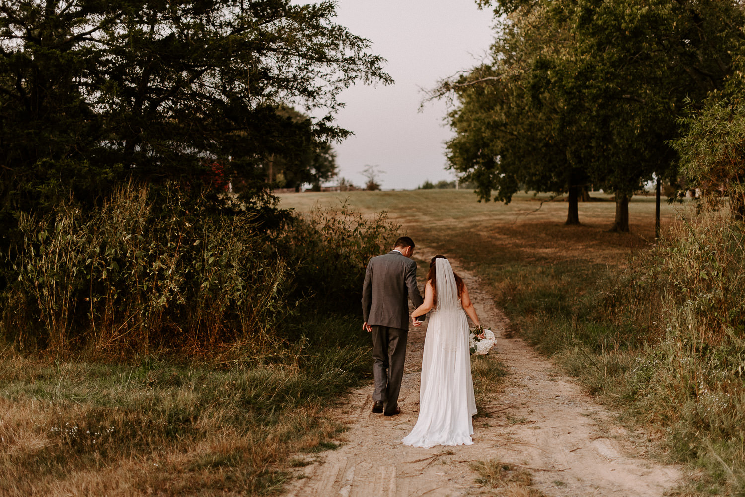 bride and groom walking at grace valley farm