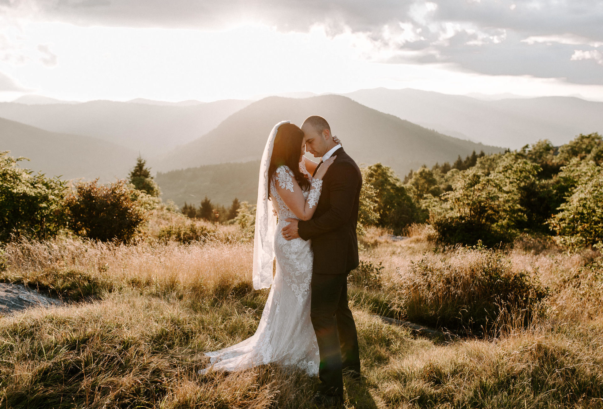 elopement bride and groom embracing at black balsam knob
