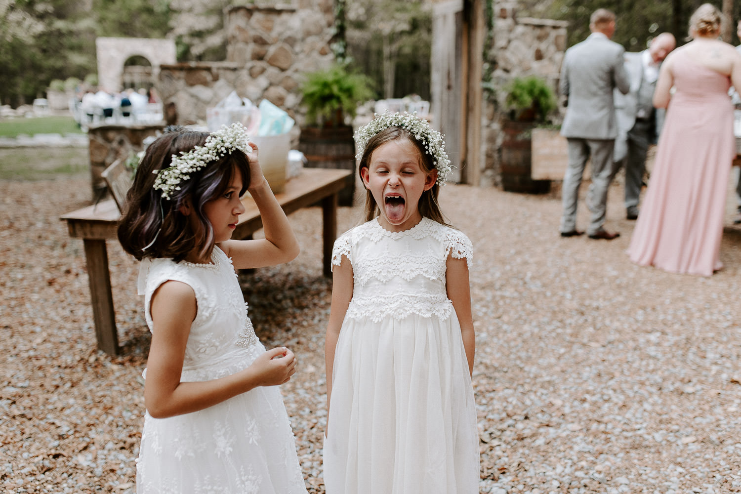 flower girls sticking out tongue